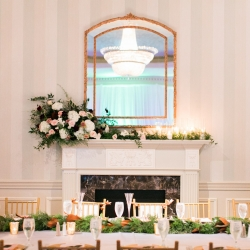 Carmel Country club served as the perfect reception site for a winter wedding featuring a sunning mantel piece of lush florals and greenery created by Jimmy Blooms