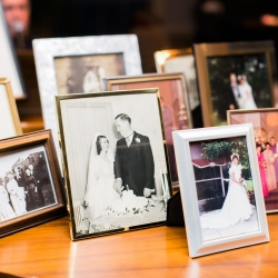 Sweet memory table shows off the bride and grooms family during their wedding reception at Carmel Country Club