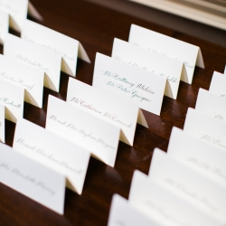 Escort cards line a table for a winter wedding at Carmel Country Club planned and designed by Magnificent Moments Weddings