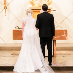 Bride and groom exchange vows during their wedding ceremony at St Gabriel's Catholic Church