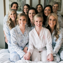 Bride poses with her brides maids in sweet matching pajamas as Be Pretty completes stunning hair and makeup