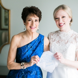 Bride gives her mother a sweet custom handkerchief as gift before her winter wedding ceremony at St Gabriel's Catholic Church in Charlotte, North Carolina