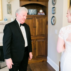 Bride shows off her gown in a first look with her father during her winter wedding captured by Ally and Bobby Photography