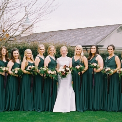 Beautiful bridal party captured by Ally and Bobby Photography features stunning emerald green gowns and burgundy accented floral bouquets created by Jimmy Blooms
