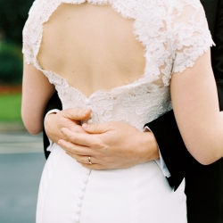 Detail shot by Ally and Bobby Photography captures a detail shot of the brides stunning dress with delicate lace details