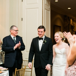 Bride and groom are introduced into their wedding reception at Carmel Country Club during their winter wedding planned by Magnificent Moments Weddings