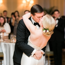 Ally and Bobby Photography captures a kiss during a winter wedding reception planned by Magnificent Moments Weddings