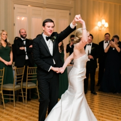 Bride and groom share a first dance to music by The Business band during their winter wedding reception captured by Ally and Bobby Photography