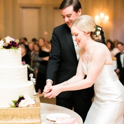 Magnificent Moments Weddings plans a sweet cake cutting ceremony during a winter wedding at Carmel Country Club