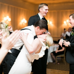 Bride and groom share a kiss on the dance floor during their winter wedding reception at Carmel Country Club captured by Ally and Bobby Photography