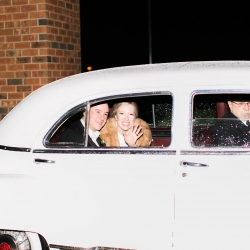 Ally and Bobby photography captures a bride and and groom as they leave their wedding reception at Carmel Country Club planned by Magnificent Moments Weddings