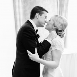 Ally and Bobby Photography capture a kiss during a winter wedding planned by Magnificent Moments Weddings