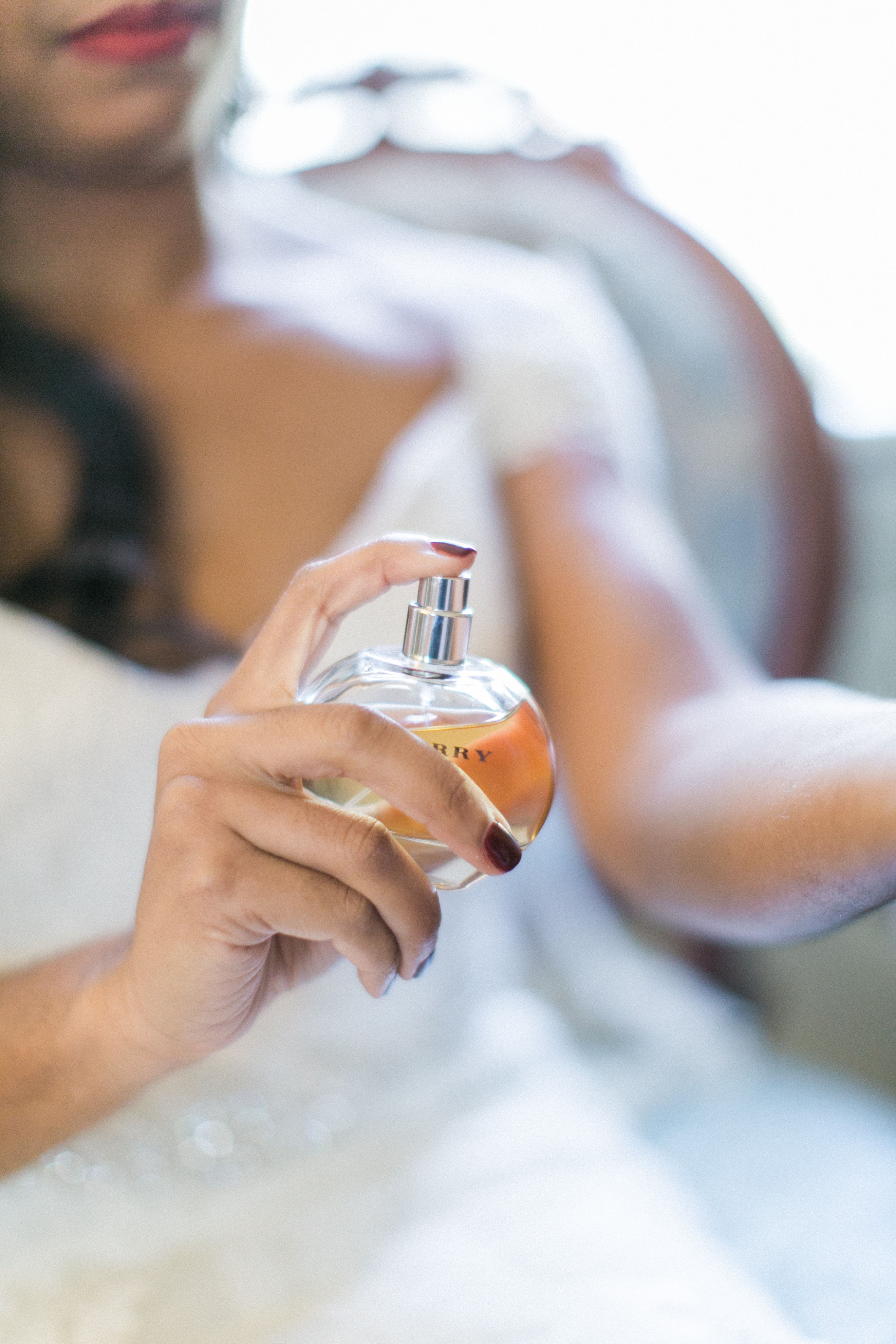 Detail shot captured by Almond Leaf Studios of bride applying perfume before her wedding at Vesuvius Vineyards