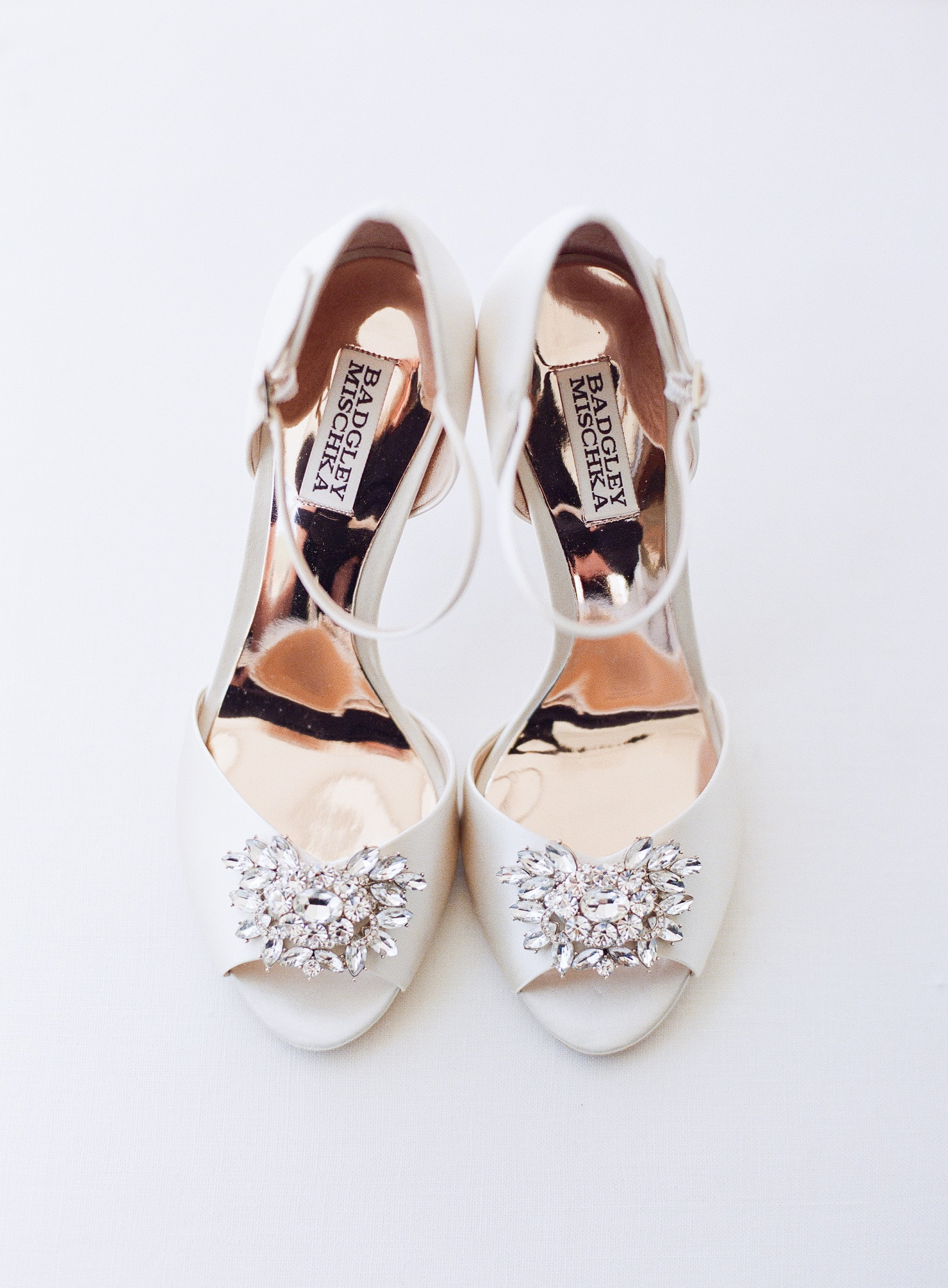 Amazing detail shot of bridal shoes captured by Almond Lear Studios
