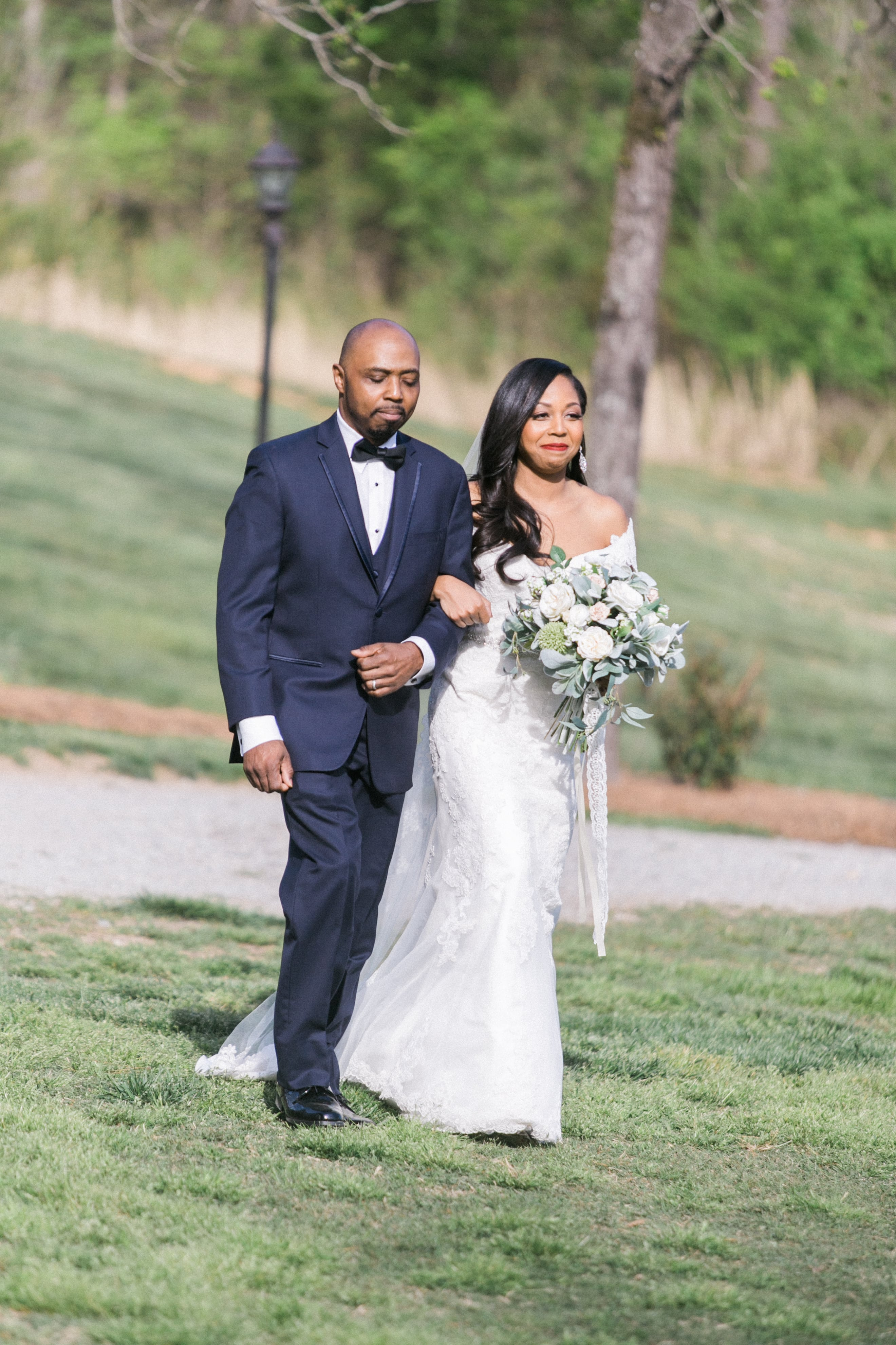 Bride being escorted down the aisle by her father for her ceremony at Vesuvius Vineyards captured by Almond Leaf Studios