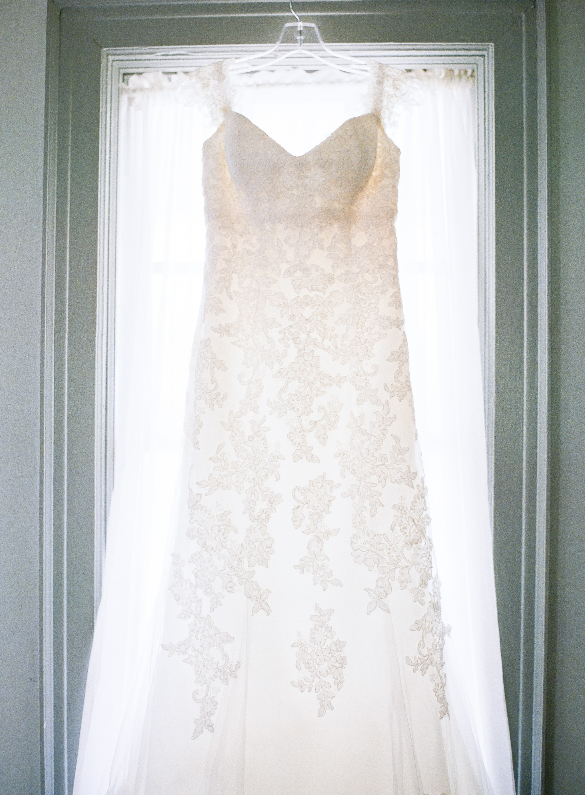 Detail shot of bridal gown for a stunning spring wedding at Vesuvius Vineyards coordinated by Magnificent Moments Weddings