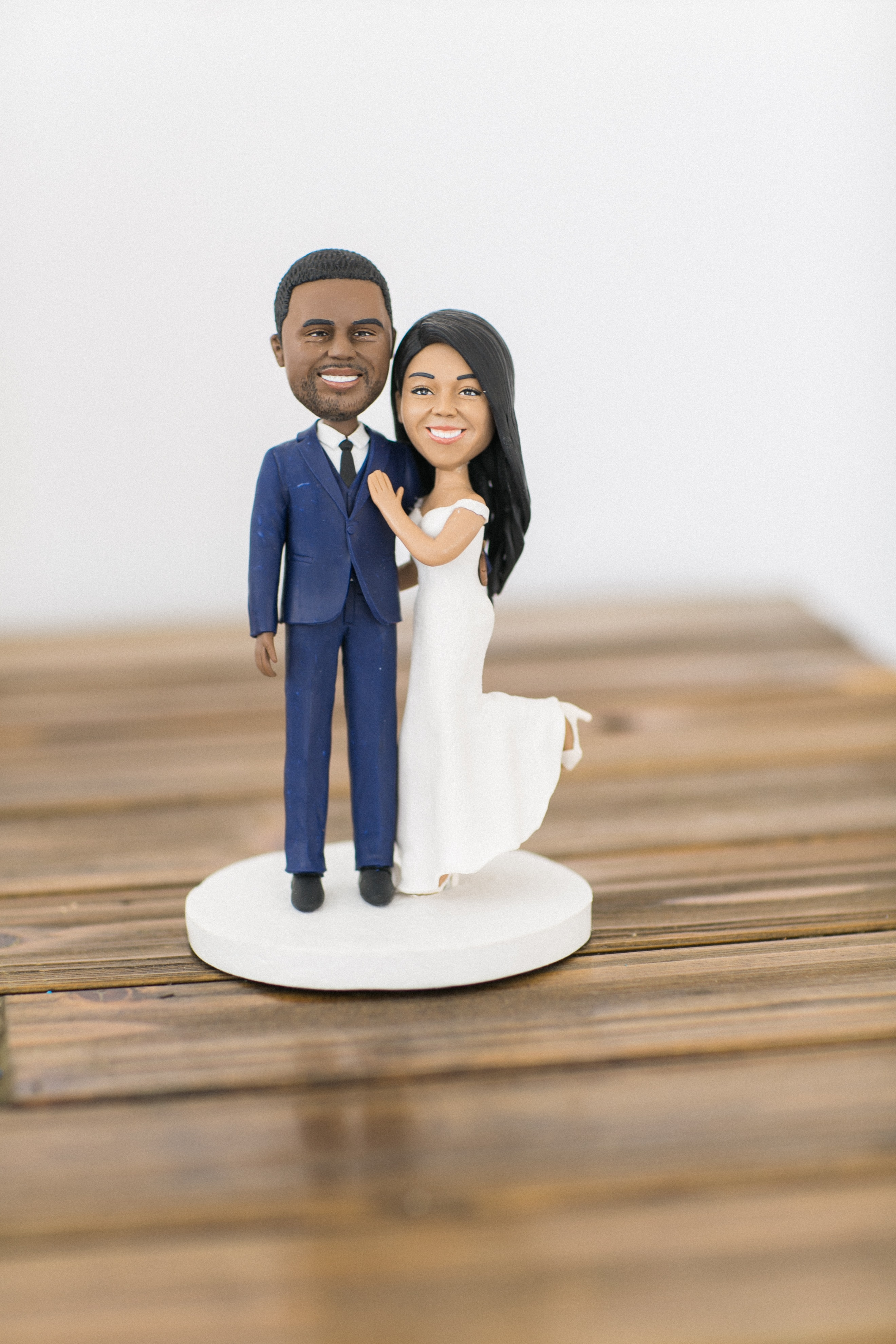 Amazing custom cake topper that resembles the bride and groom captured by Almond Leaf Studios