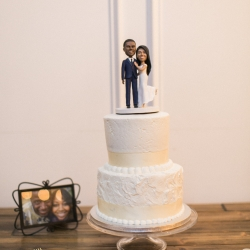 Simple two layers white wedding cake by Publix Bakery with customer cake topper placed at a wedding reception at Vesuvius Vineyards and captured by Almond Leaf Studios