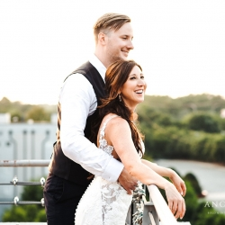 Bride and groom pose for Anchor and Veil Photography on the balcony of Terrace at Cedar Hill