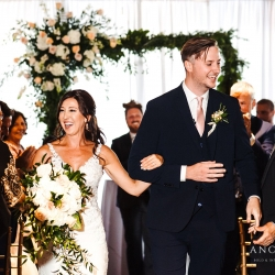 Bride and groom are all smiles after exchanging vows during a wedding ceremony coordinated by Magnificent Moments Weddings