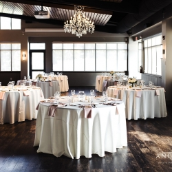 Simple white linens and blush napkins are the perfect touches for a summer wedding in Uptown Charlotte