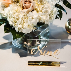 Elegant table numbers and lush centerpieces by Midwood Flower Shop are the perfect touches for a summer wedding in Uptown Charlotte
