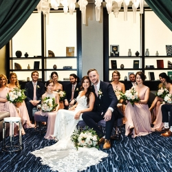 Bride and groom pose with bridal party as they relax before exchanging vows at Terrace at Cedar Hill