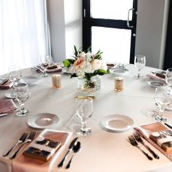 White linens and blush napkins are the perfect form of elegance for a summer wedding at Terrace at Cedar Hill