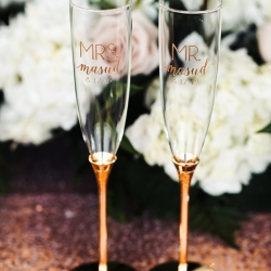 Anchor and Veil Photography captures the small details including custom champagne flutes for the bride and groom