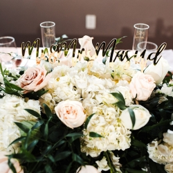 Lush flowers for Midwood Flower Shop and a new name tag show off the head table and the couples new last name