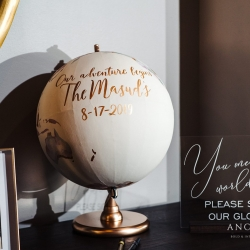 A fun globe served as the couples guestbook a nod to their love of travel all coordinated by Magnificent Moments Weddings