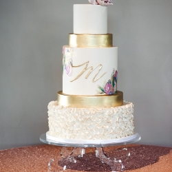 Amazing five tier cake from WoW Factor Cakes features modern gold layers and the couples monogram