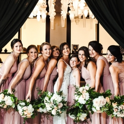 Bride poses with her bridesmaids as they prepare for wedding day at Terrace at Cedar Hill