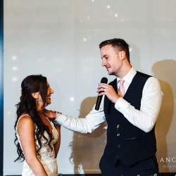 Groom shares a touching speech with his now bride during their summer wedding captured by Anchor and Veil Photography
