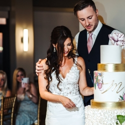Bride and groom cut their stunning cake created by WoW Factor Cakes