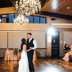 Bride and groom share their fist dance to music provided by Split Second Sound during their wedding reception coordinated by Magnificent Moments Weddings