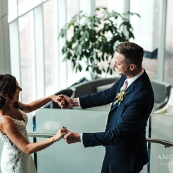 Bride and groom are all smiles after their first look coordinated by Magnificent Moments Weddings and captured by Anchor and Veil Photography
