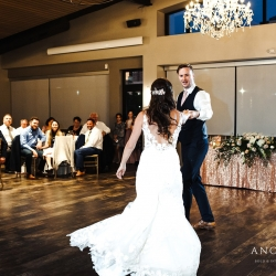 Bride and groom share a fist dance during their summer reception at Terrace at Cedar Hill