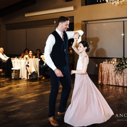 Anchor and Veil Photography captures a groom dancing with his new step-daughter during their summer wedding reception