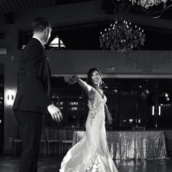 Bride and groom share a last dance coordinated by Magnificent Moments Weddings under the chandeliers at Terrace at Cedar Hill