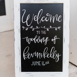 Welcome sign for guests attending a spring wedding at The Diary Barn coordinated by Magnificent Moments Weddings.