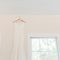 Detail shot of bridal gown on custom name hanger captured by Ashley Sue Photography