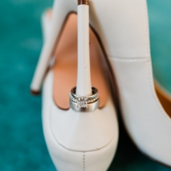 Bridal rings and shoes shown off by Ashley Sue Photography before a spring wedding at The Diary Barn