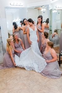 Bride getting hair and makeup done with bridesmaids by Beauty Asylum captured by Ashley Sue Photography