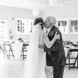 Bride shares a moment with family at her Dairy Barn wedding in Fort Mill, South Carolina captured by Ashley Sue Photography