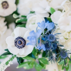 Stunning florals for a spring wedding at The Diary Barn by Wild Petal Studios featuring white flowers with accents of blue
