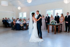 Bride and groom share their first dance to music by Split Second Sound at a wedding reception at the Dairy Barn