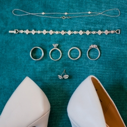 Detail shot of bridal jewelry captured by Ashley Sue Photography for a spring wedding at The Dairy Barn