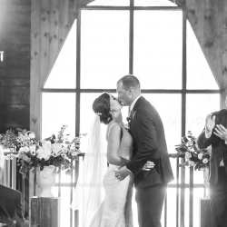 Bride and groom kiss at their Dairy Barn Ceremony coordinated by Magnificent Moments Weddings and captured by Ashley Sue Photography