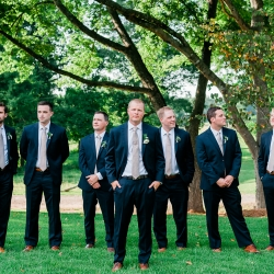 Groom poses with groomsmen on the grounds of The Dairy Barn in Fort Mill, South Carolina